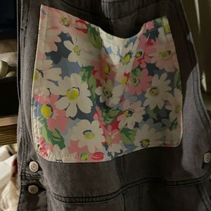 Gray distressed denim overalls with floral